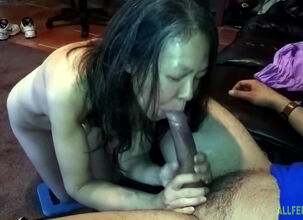 Asian woman sucking cock